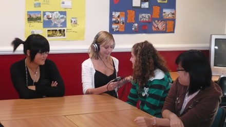 Photo of an interviewer speaking to students.