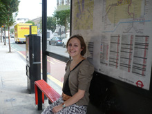 Photo of a woman at a bus stop in Kings Cross
