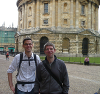 Two men standing outside the Radcliffe Camera